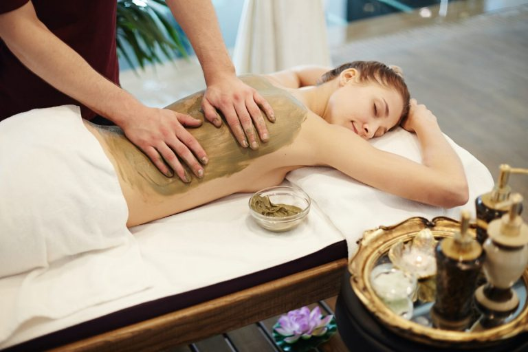 woman-enjoying-mud-massage-in-spa.jpg